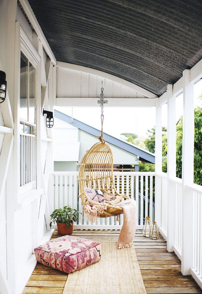 "**Front verandah** ""This is a tiny area, but it's so relaxing in the afternoons,"" says Geneva. She can sway on The Bach Living hanging chair while Ben flops out on a Moroccan floor cushion from Marr-kett. Throws & lanterns, [West Elm](http://www.westelm.com.au/