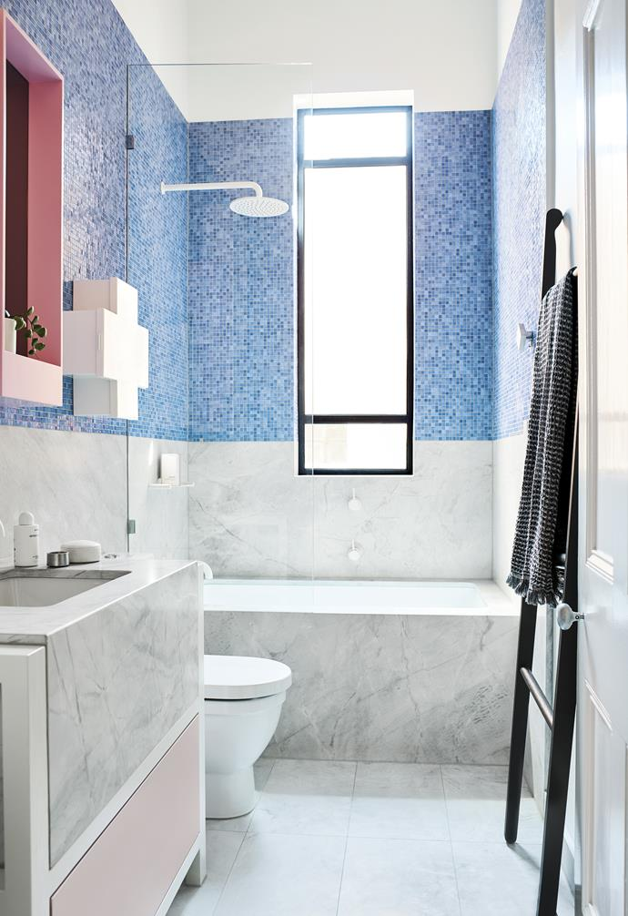 "**Dive on in** The boldness of the blue tiling and the pink accents on the mirror and vanity drawers are balanced by the neutral tones of the marble, which stretches halfway up the wall. *Design: [Lucy Bock Design Studio](https://www.lucybock.com/|target=""_blank""