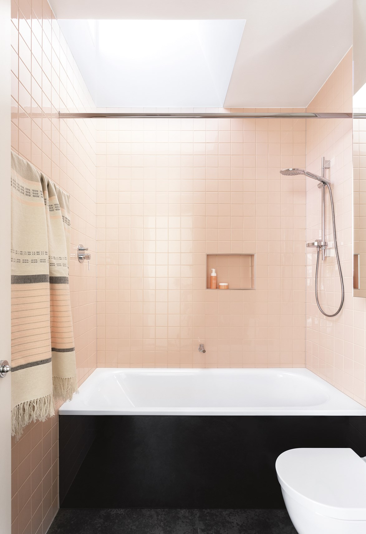 Ok, so it may not be *Millennial* but this powdery pink bathroom still has us head over heels. A skylight and large mirrored cabinet keep the entire room feeling bright and open, bouncing light off the dusty-pink tiled wall. *Design:* Wowowa Architecture & Interiors   *Styling:* Ruth Welsby   *Photography:* Martina Gemmola.