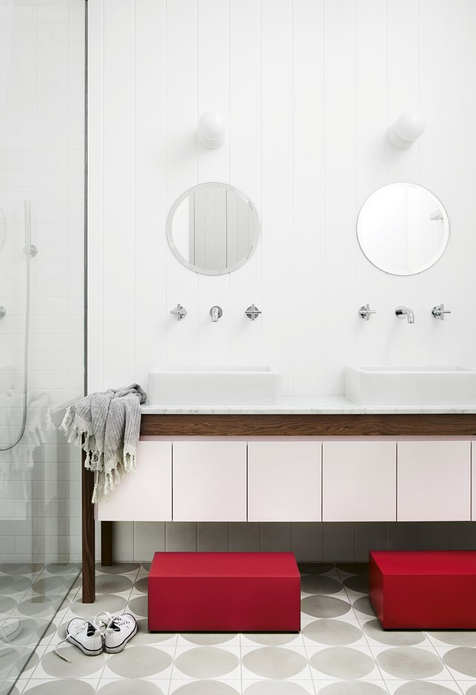 "**Step up** Designed with daughters in mind, the soft pink cabinetry is played up by the red footstools. The statement grey flooring ensures that the space is still on-point as the girls get older and no longer need the stools. *Design: [Carole Whiting Interiors & Desig](https://www.carolewhiting.com/|target=""_blank""
