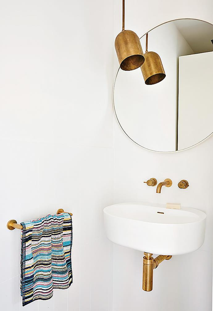"**Go for gold** Crisp white is set off by metallic accents in this elegant bathroom, with even the pipework offering a subtle sparkle. An Anaesthetic 'Duomo' pendant offers a shapely touch above eye level. *Design: [Tecture](http://www.tecture.com.au/|target=""_blank""