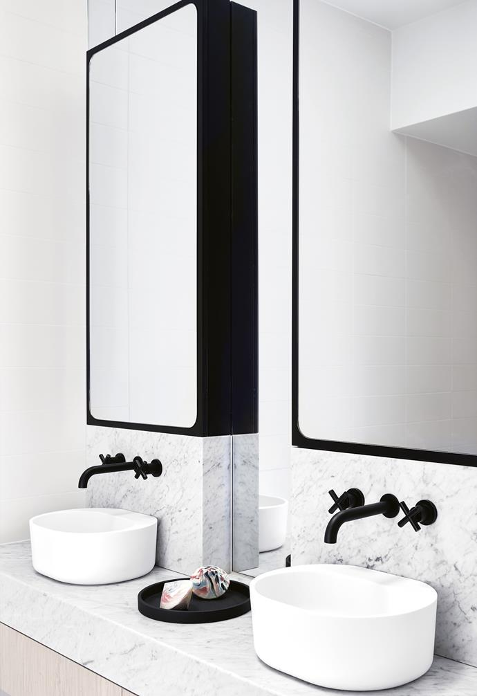 "**Seeing double** Twin basins add a sense of balance to this minimalist space, while also acting as a functional zone for a busy family. Matt black taps pop against the honed marble surface. *Design: [Watts Studio](https://www.wattsstudio.com.au/|target=""_blank""