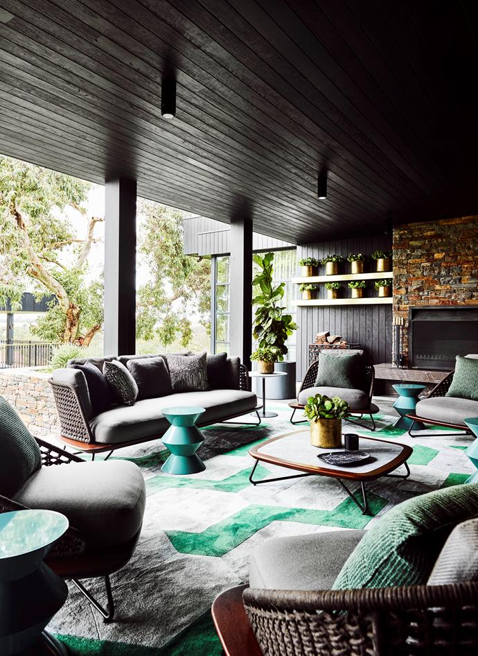 Dark timbers create an indoor-outdoor connection as well as the desired luxe factor for this Barwon River home designed by Greg Natale. *Photograph*: Anson Smart. From *Belle* October 2018. Featured in 'The Patterned Interior' by Greg Natale, $90, Rizzoli New York, 2018.