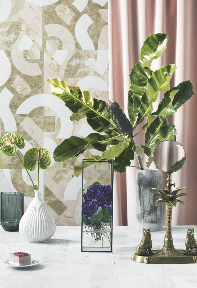 "**Master the mix** ""A single banksia contrasts with a cluster of sweet violets contained within the framework of the vase,"" — Myra Perez.<br><br>  *Vases from left*: 'Colour' vase in Green, $99, [Hay](http://hayshop.com.au/