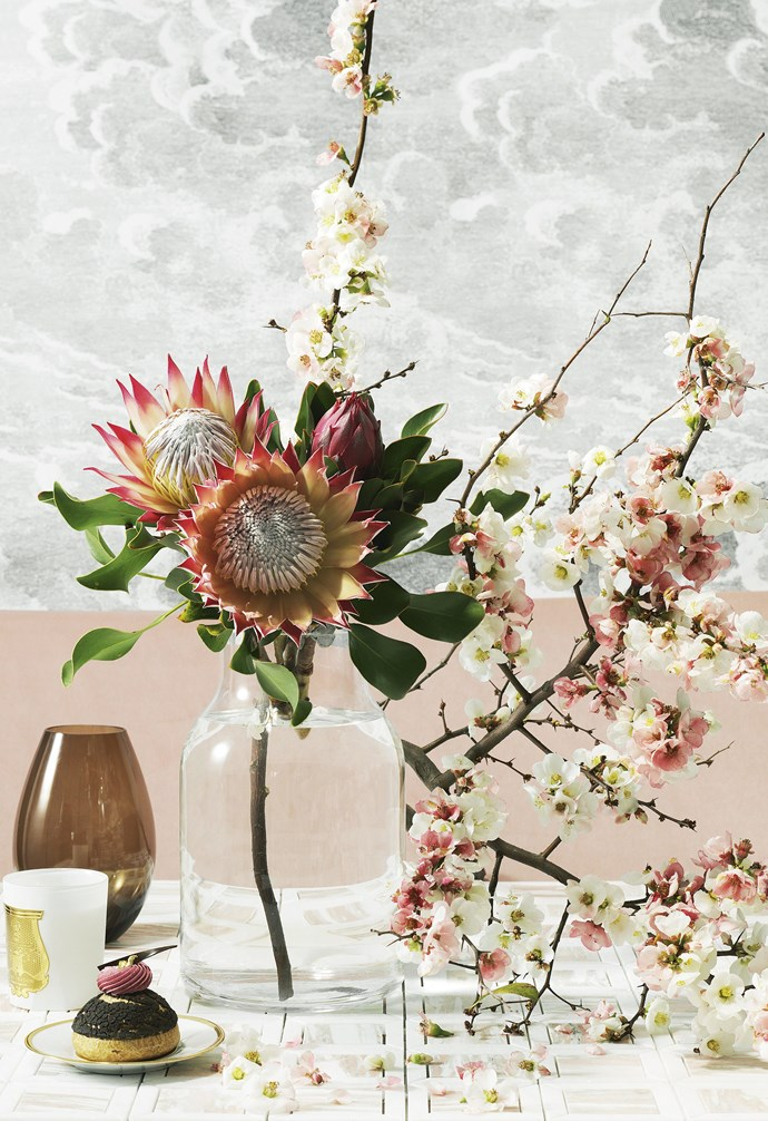 "**Unexpected combination** ""Peach-toned blossoms are a match for the impressive pink protea flowers. You'll need A heavy vase to support the arrangement"" — Myra Perez.<br><br>  *Get the look*: Holmegaard 'Cocoon' vase in Brown, $125, [Top3 By Design](http://top3.com.au/