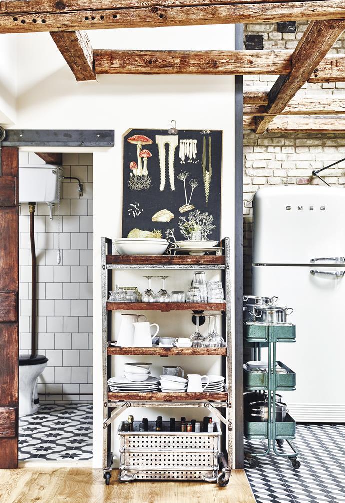 "**Kitchen** Black-and-white cement tiles from Mosaic del Sur define the kitchen in the open-plan layout, while a retro Smeg fridge fits their look. 'FAB50RWHAU' fridge, [Smeg](http://www.smeg.com.au/|target=""_blank""|rel=""nofollow""). Mushroom poster, Bukowskis."