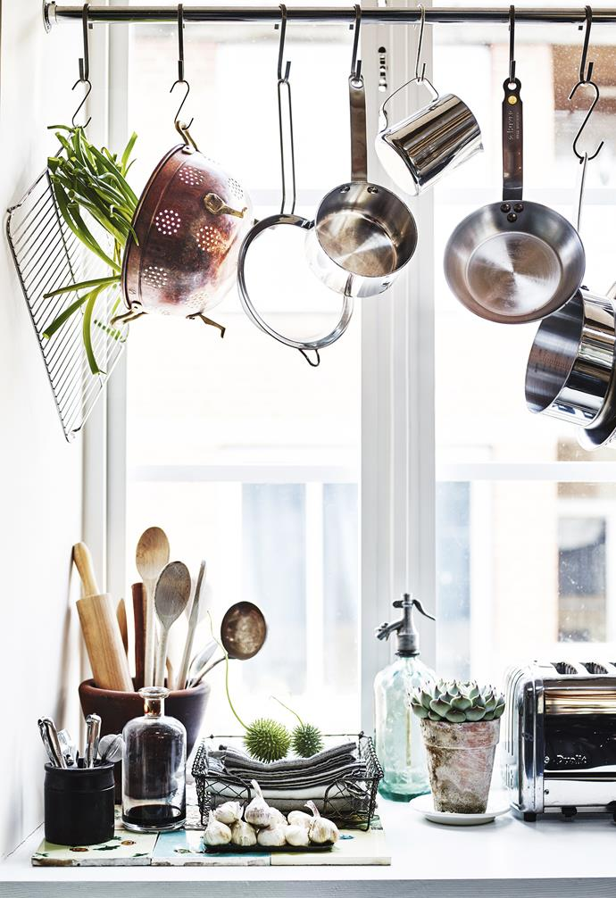 """**Kitchen** """"I wanted a combination of materials to achieve the feeling that it has been here for many years,"""" says Sam, who made use of window recesses by hanging her utensils on hooks."""