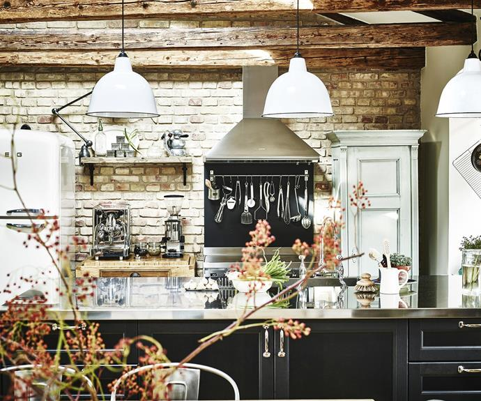 """**Kitchen** Sam chose to highlight the brick wall instead of covering it with cabinets. """"I love leaving kitchen utensils and pots out,"""" she says. """"It provides a warm country-kitchen feeling."""""""