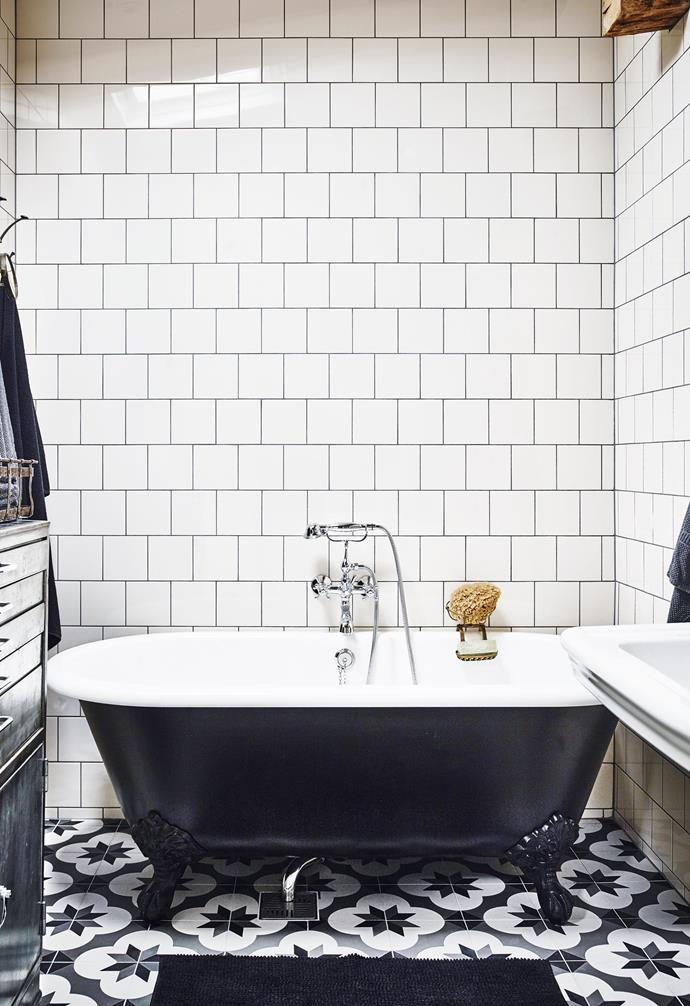 """**Bathroom** A vintage feel has also been created here, with off-white wall tiles, a repurposed cabinet and a clawfoot tub painted by Sam. """"I thought I'd made the mistake of my life after the first coat of paint, but after three coats it was a success!"""" she says. Mosa wall tiles, [Design Republic](https://designrepublic.net.au/