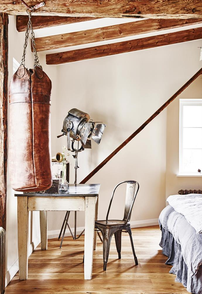 **Master bedroom** Rich texture and aged materials create a cosy, welcoming feel in Sam and Grant's room. The punching bag and stage light were found at Castle Gibson in London. Sam's cherished filing cabinet is tucked in the corner beneath a framed teatowel of a budgie from Third Drawer Down.