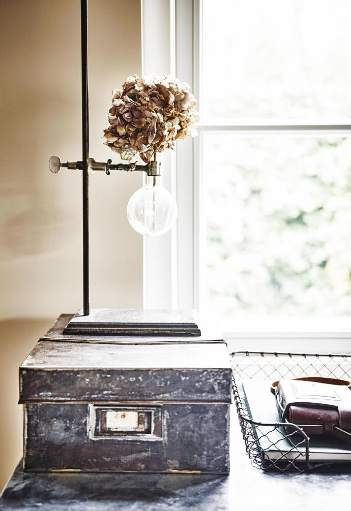 **Bedroom details** The table features a vintage cast-iron laboratory stand with Pyrex flask, bought in the US.