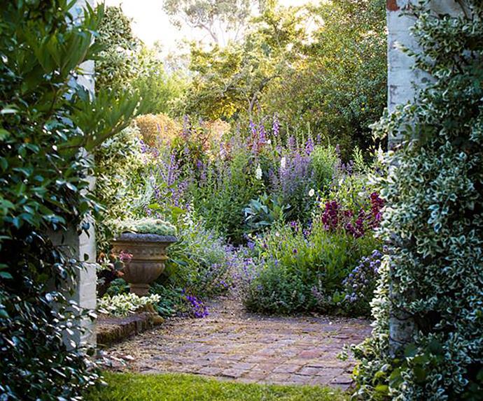 Spring garden with cobblestone path
