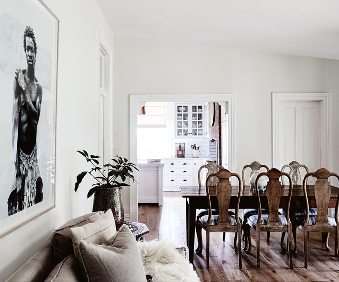 """In the living area, the dining setting is from Belgium. The photographic print *Namibia Village Man* is by [Kara Rosenlund](https://www.homestolove.com.au/a-day-in-the-life-of-stylist-kara-rosenlund-3777