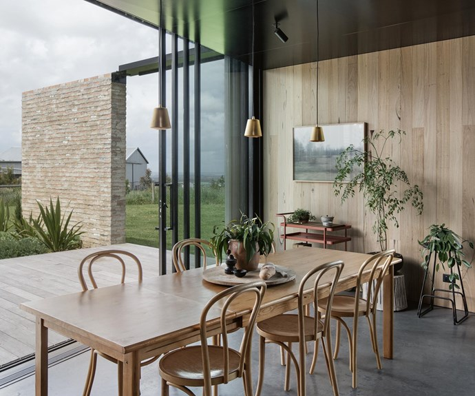 In the living area, the 'Trace' drinks trolley by Adam Goodrum is from [Tait](https://madebytait.com.au/). The bentwood chairs are by [Thonet](http://www.thonet.com.au/) and pendant lights are from [EOQ Design](http://www.eoq-design.com/). | Photo: Ben Hosking