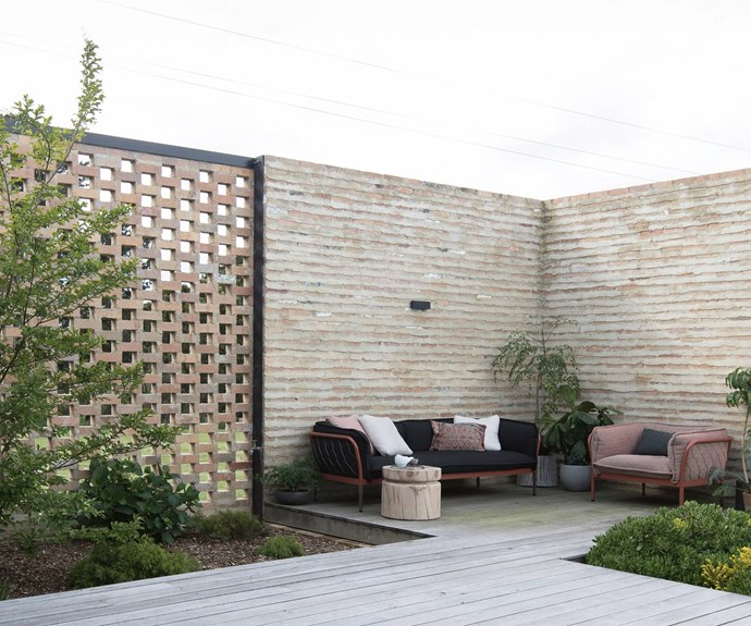 Recycled brick was used for the exposed brick walls. Outside, the couple breeds cream Legbar and copper Maran chickens, while tending to a large vegetable garden and an orchard.  | Photo: Ben Hosking