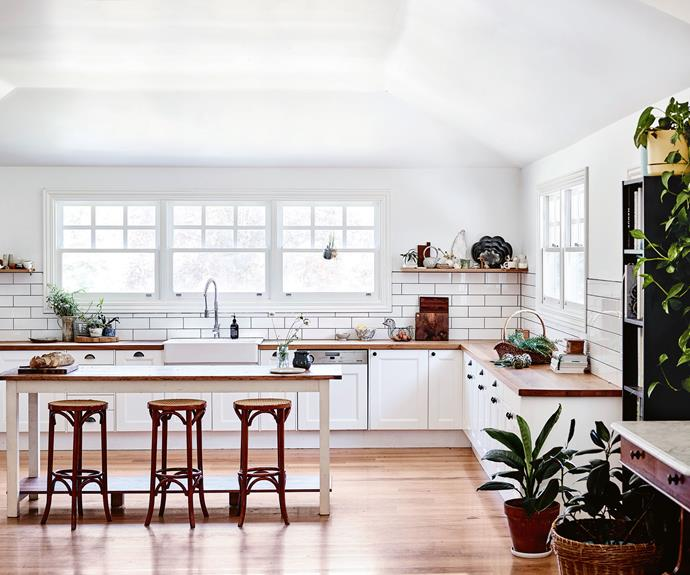 The kitchen was built by the previous owners, one of whom was a furniture maker. The marble-topped carving table belonged to Elizabeth's grandmother and once sat in historic Quamby in northern Tasmania. Three high stools were second-hand bargains.