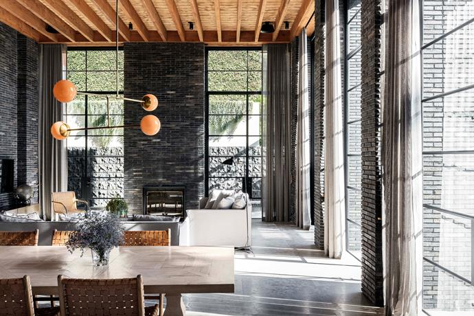 The warm-toned recycled oregon timber rafters are complemented by the black Swedish steel-framed doors.