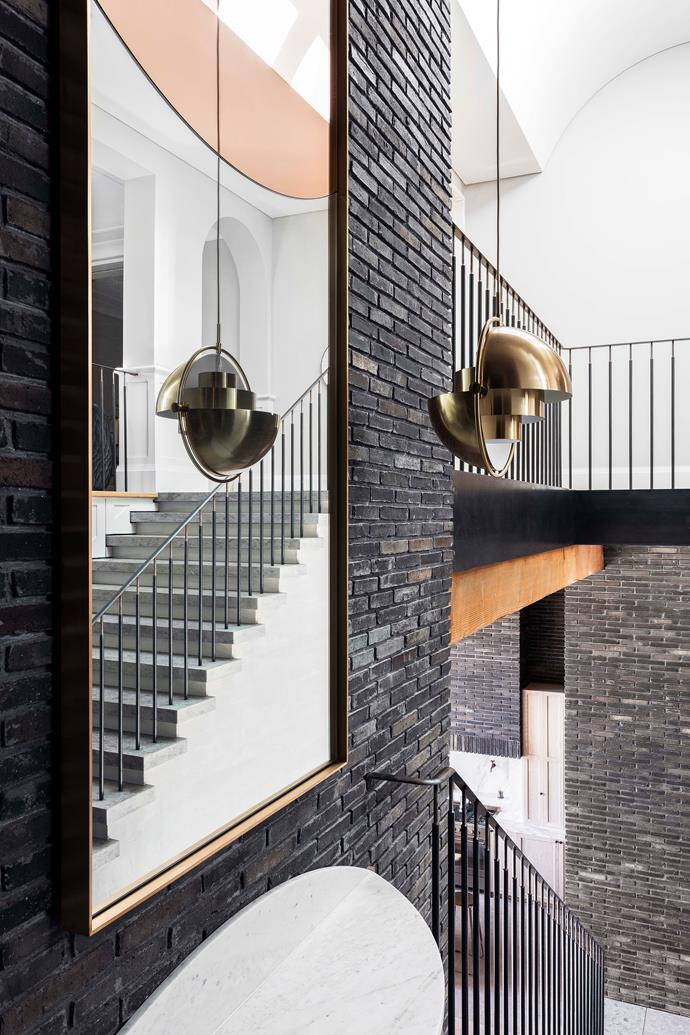 """The awe-inspiring entrance links the original house with the new space via a [statement staircase](https://www.homestolove.com.au/statement-staircases-6589
