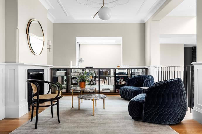 """The upstairs sitting room in the original section of the home has a sense of understated luxe, with a pair of [velvet armchairs](https://www.homestolove.com.au/velvet-chair-trend-2017-6002