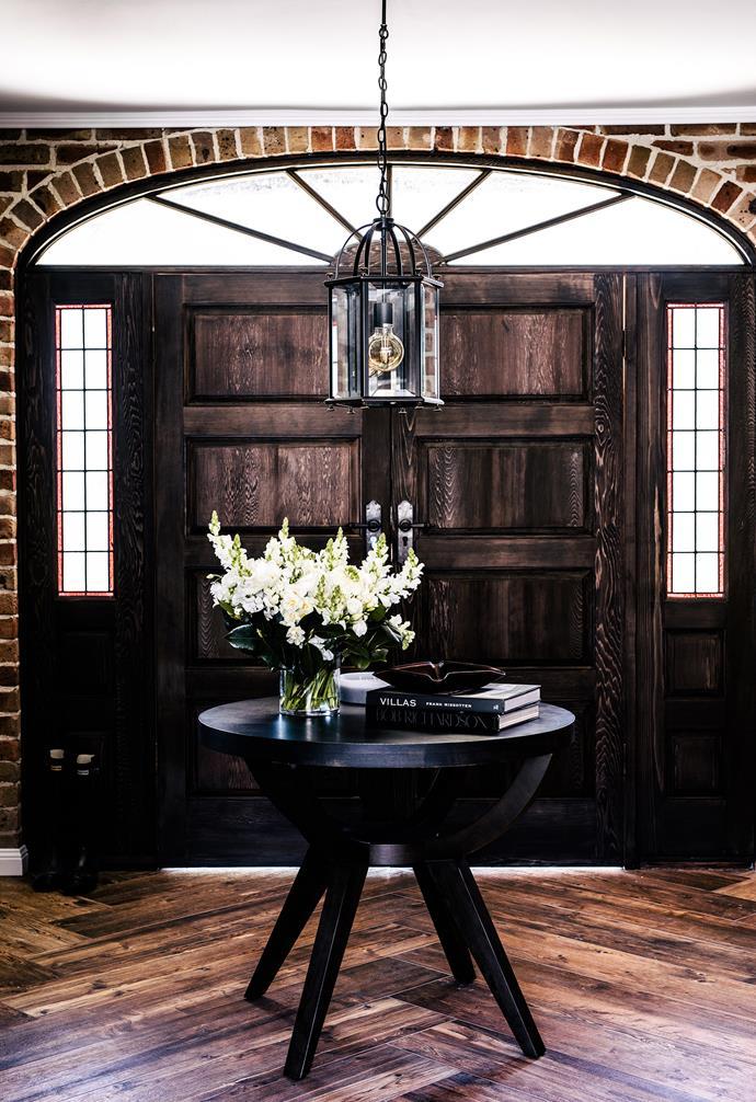 "**Entryway** This home is a modern interpretation of the rustic farmhouse. Pendant light, [Restoration Online](http://www.restorationonline.com.au/|target=""_blank""|rel=""nofollow""). Custom table. Candle, [Zakkia](https://www.zakkia.com.au/|target=""_blank""|rel=""nofollow"")."