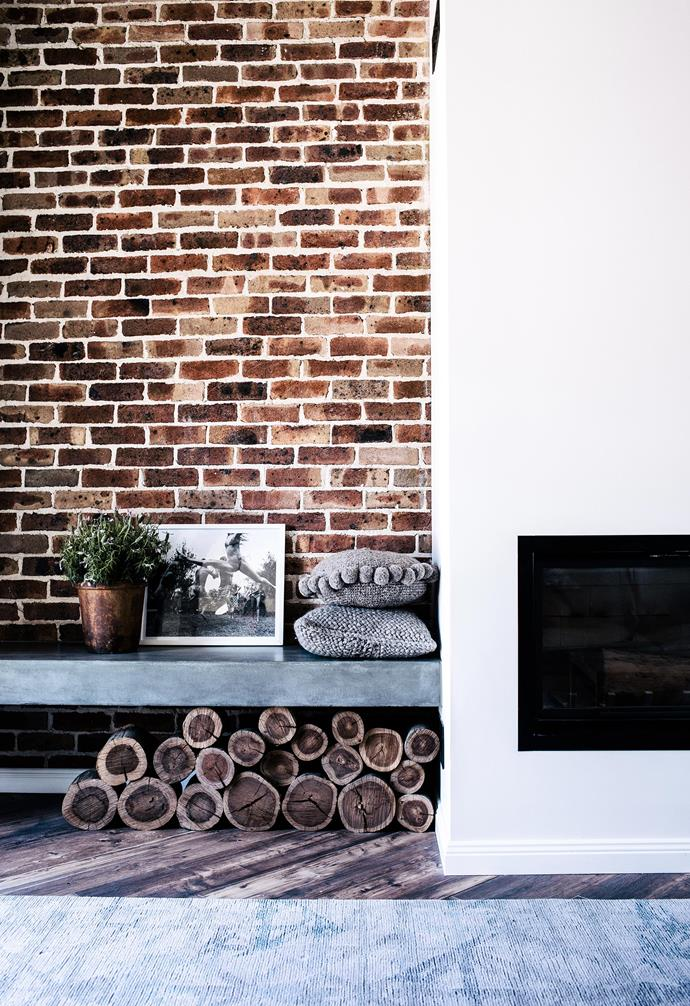 """**Fireplace** The in-built concrete bench is a clever use of space beside the fireplace. Cushions, [Pampa](https://pampa.com.au/