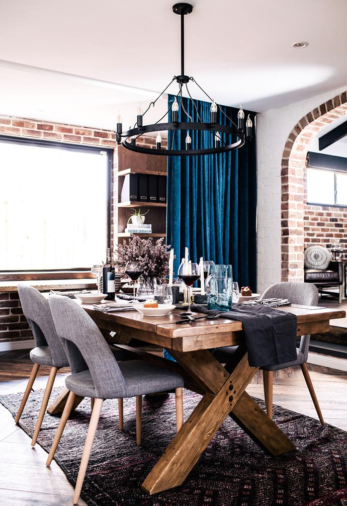 "**Dining room** A rich teal curtain pops against the white and red brick walls, while a heavy timber dining table is the hero of the room. upholstered dining chairs with timber legs continue the material palette. Tablecloth used as runner, [Cultiber](https://cultiver.com.au/|target=""_blank""