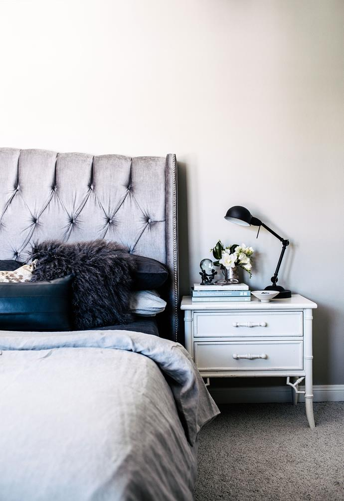 """**Bedroom** A silver bedhead makes a statement in the bedroom and pairs beautifully with the white side table. Bedding, [Cultiver](https://cultiver.com.au/