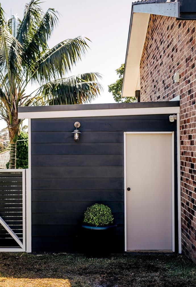**Backyard** A fresh lick of dark paint makes this space pop.