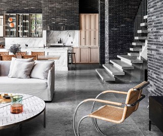 Modern living room with dark exposed brick walls