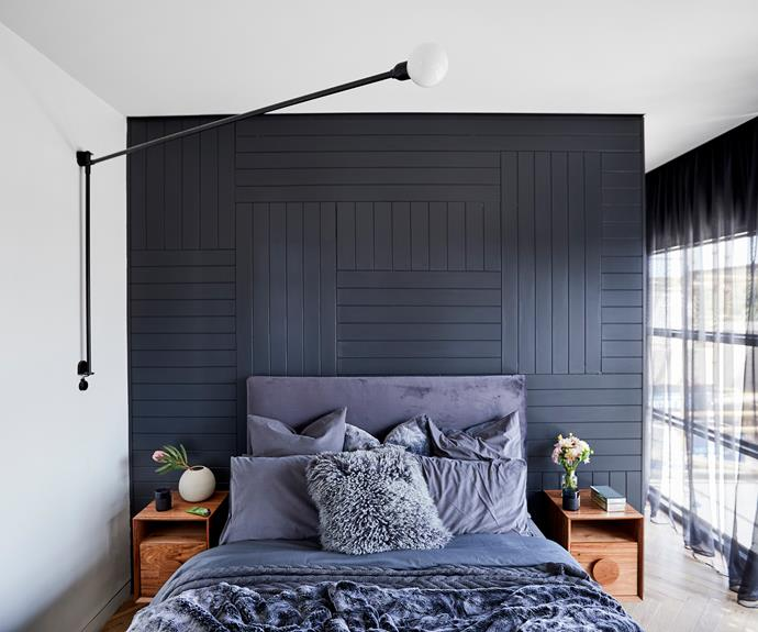 "**Bianca and Carla** A dark panelled feature wall plays beautifully with the multiple textures of grey on the bed, with the added bonus of making the floating timber bedside tables from [Ingrain](https://www.ingraindesigns.com.au/|target=""_blank"") pop."