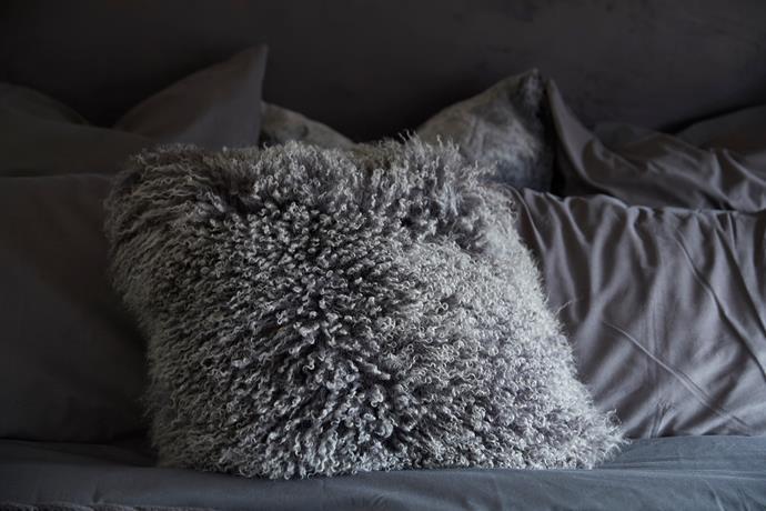 "Mongolian lamb **cushion cover** in platinum, $99, from [West Elm](http://www.westelm.com.au/mongolian-lamb-pillow-covers-square-t3440?quantity=1&attribute_1=41%20x%2041%20cm&attribute_2=Platinum|target=""_blank""|rel=""nofollow"")."