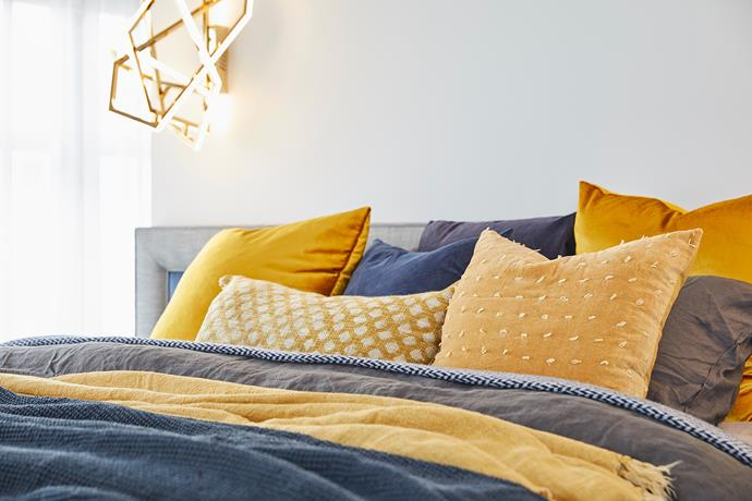 """'Sintra' **cushion** in ochre, $72.95, from [Zanui](https://fave.co/2NE6X7t