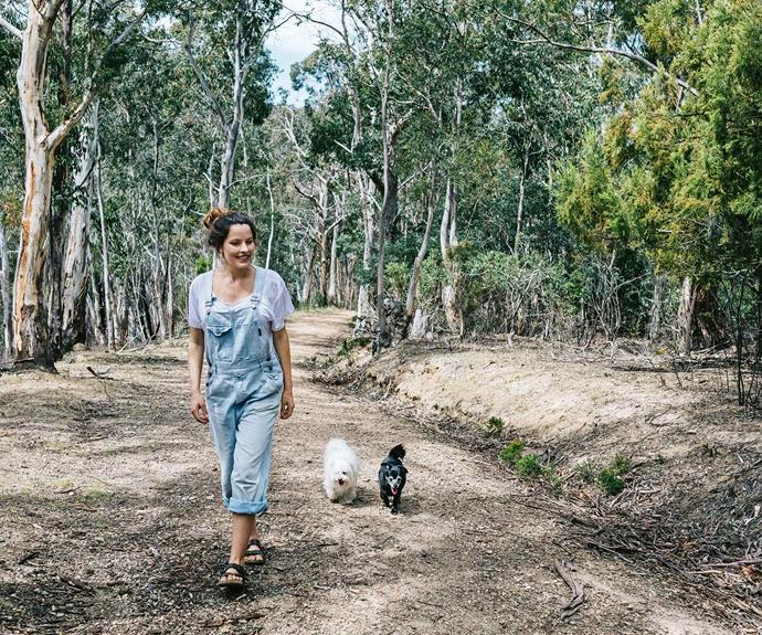"Brigitte takes a stroll with Gypsy and Tommy, her Chihuahua cross mini Fox Terrier. ""We were lucky to get this [little house in the bush](https://www.homestolove.com.au/tiny-home-in-the-hunter-valley-13707