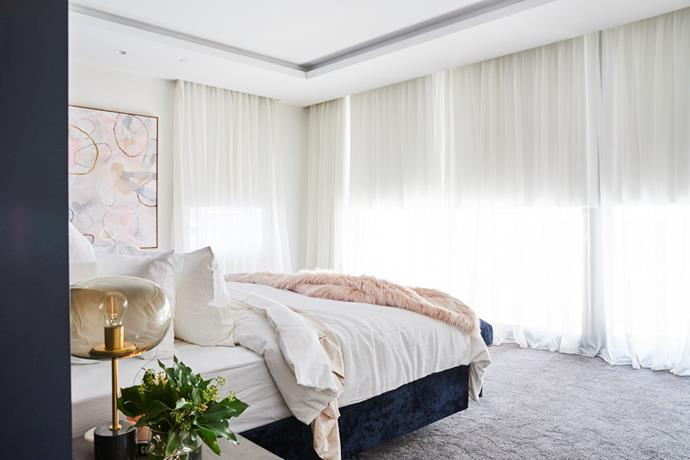Hayden and Sara's choice of sheer curtains softens their master bedroom and allows plenty of natural light to flood the room.