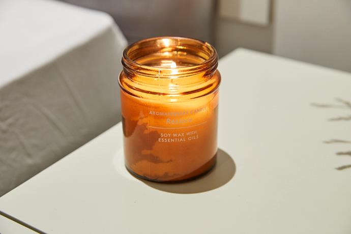"""Fresh air is always best, but this $6 candle used by Kerie and Spence in their guest bedroom from [Kmart](https://www.kmart.com.au/product/indulgence-aromatherapy-candle/1657810