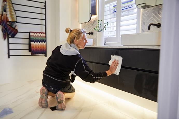 Kerrie demonstrates the importance of removing all builder's dust to present a clean and tidy room, ready for potential buyers to walk through.