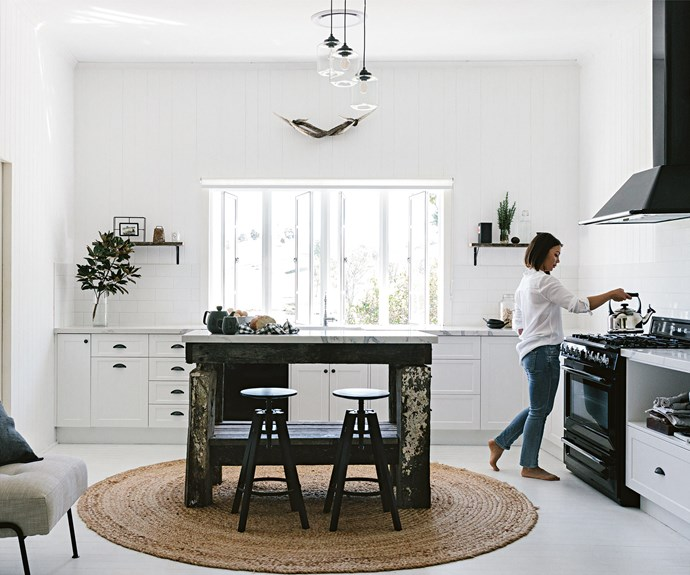 """Maree puts the kettle on in the light-filled kitchen. The island bench is tallowwood, topped with [Smartstone](http://www.smartstone.com.au/