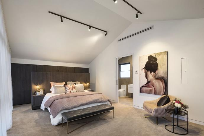 **Master bedroom:** Continuing their signature monochrome and blush pink palette into their master bedroom, Ronnie and Georgia delivered a romantic parent's retreat with a walk-in wardrobe to die for. The statement artwork was a standout as was the ingenious way the couple concealed the TV - by having it pop out from the wall.