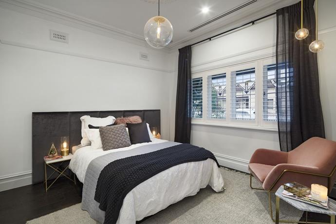 **Guest bedroom:** Even without an ensuite and walk-in wardrobe, Ronnie and Georgia's dreamy guest bedroom won them first place. With its dark floorboards, sheer curtains and touches of blush pink, this was one luxurious and romantic room.