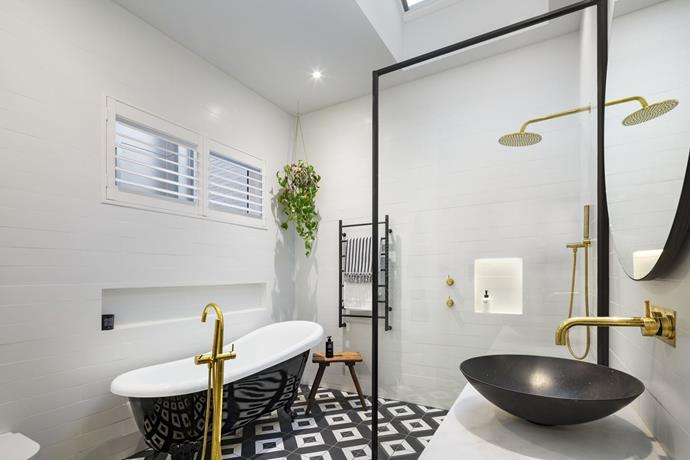**Bathroom:** The bath filler may have been placed in the wrong spot but everything else in Ronnie and Georgia's bathroom was spot on. The gleaming gold tapware and patterned floor tile brought the wow factor while the clawfoot bathtub added a touch of old-school charm.