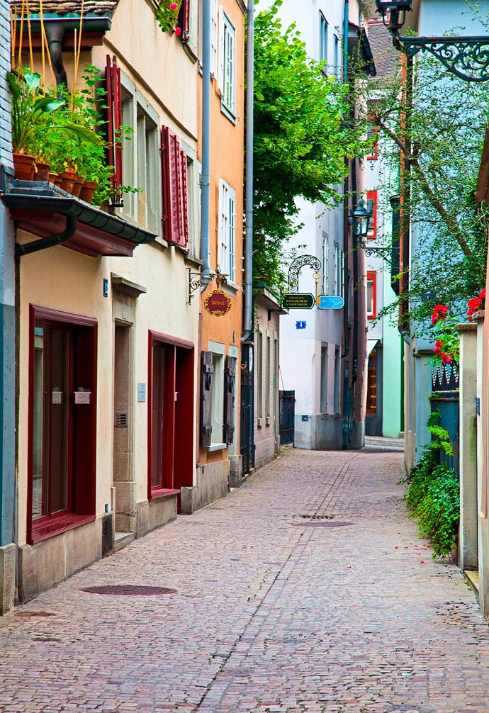 **Zurich, Switzerland** Cobblestones and narrow lanes abound in Zurich, where the buildings are a mix of colourful and minimalist. *Photography: Alamy*.