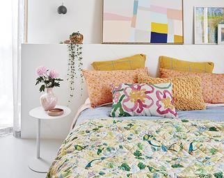 Bed with colourful spring linen