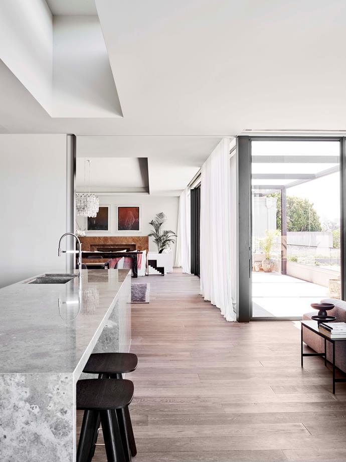 """The sophisticated layering of textures makes the [open-plan kitchen](https://www.homestolove.com.au/open-plan-kitchen-design-by-arent-and-pyke-4654