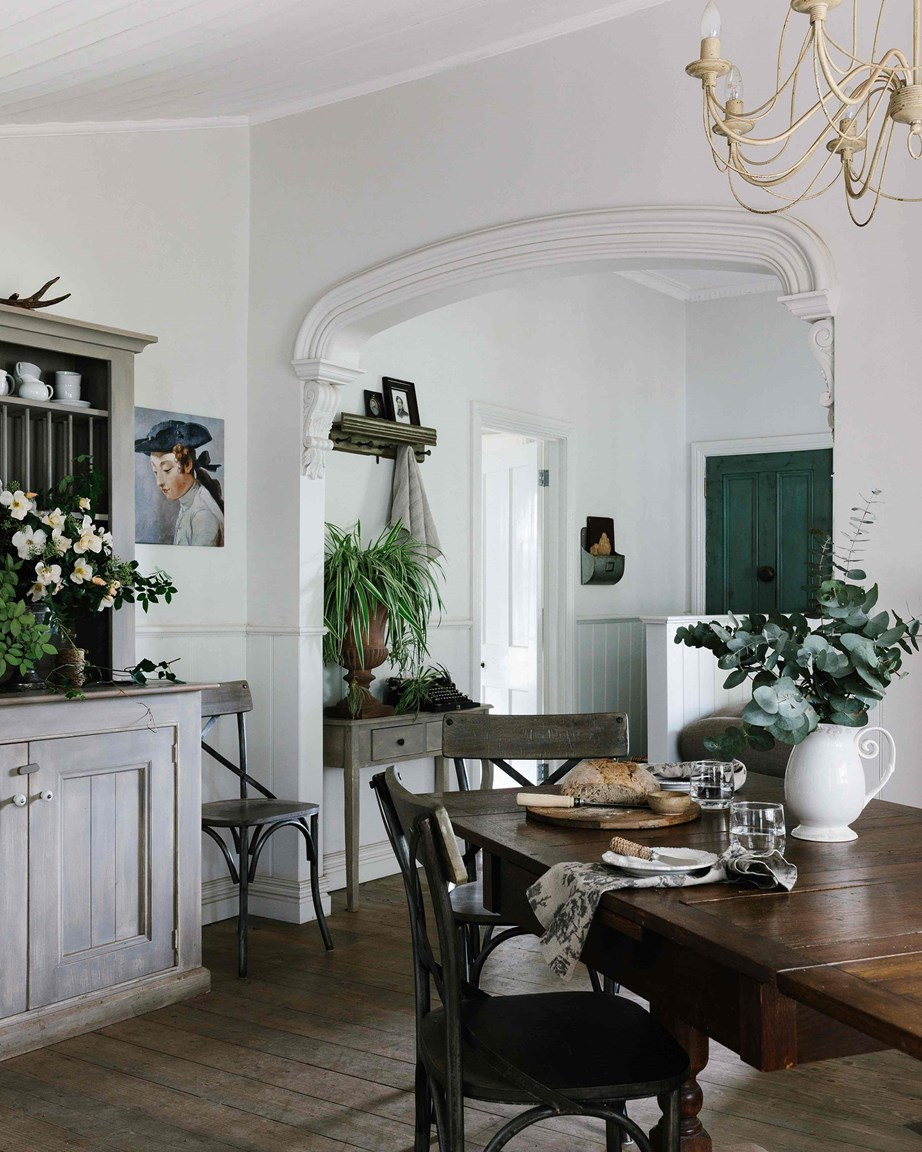 "From the oak table and chairs to the Jean Baptiste print by French painter Pascal Amblard and fresh foliage a flowers foraged from the garden, the interiors of this [19th-century cottage on a rose farm](https://www.homestolove.com.au/flower-farm-property-victoria-18945|target=""_blank"") in Trentham, Victoria, have a strong French influence without being ""too frilly or fluffy""."