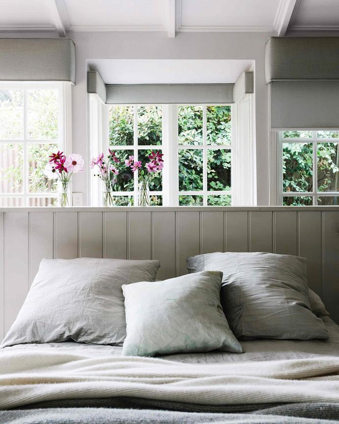 """Rob rebuilt the master bedroom, installing new windows, raising the roof and making the wooden bedhead. Bed linen is [Cultiver](https://cultiver.com.au/ target=""""_blank"""" rel=""""nofollow"""") with blankets by [Bemboka](https://bemboka.com/ target=""""_blank"""" rel=""""nofollow""""). *Photography: Marnie Hawson*"""