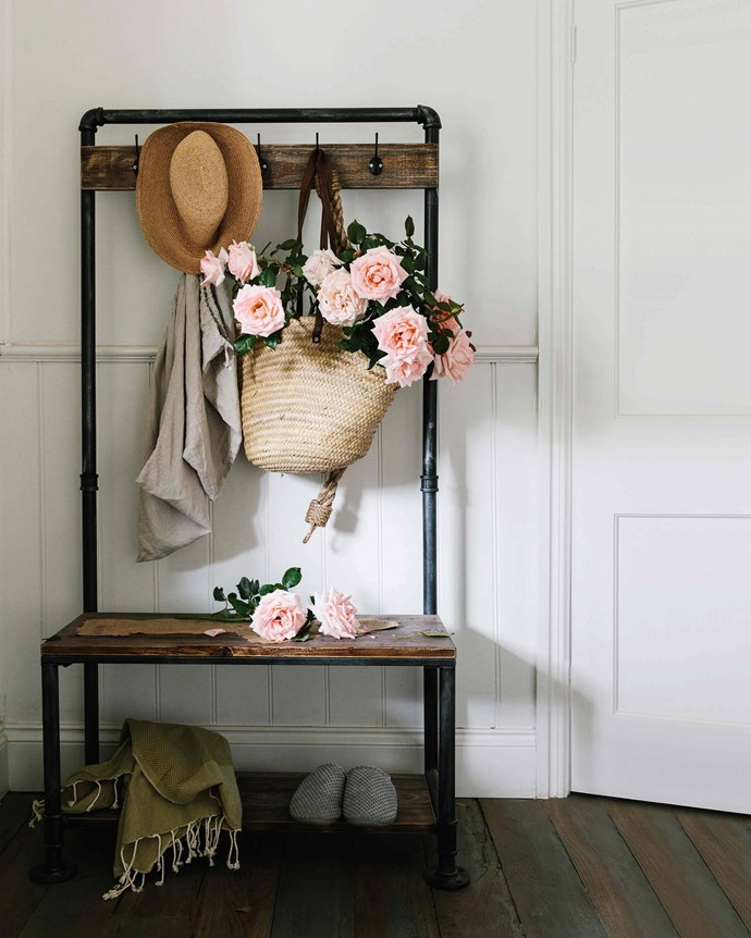 'Cinderella' hybrid tea roses overflow from a basket on the vintage clothes stand that Sandy found on eBay. *Photography: Marnie Hawson*