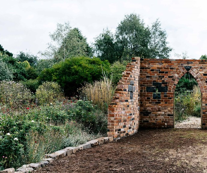 The brick folly by Tom Hamlin of Hamlin Landscapes is the centrepiece of the rose garden and was built using recycled bricks. *Photography: Marnie Hawson*