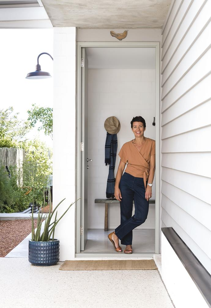 """**Entry** Homeowner Anna has filled her home with personal touches, such as this blue pot (a gift) and a prized ceramic dove by Gerry Wedd above the door. Timber bench, [Kartique](https://www.kartique.com.au/