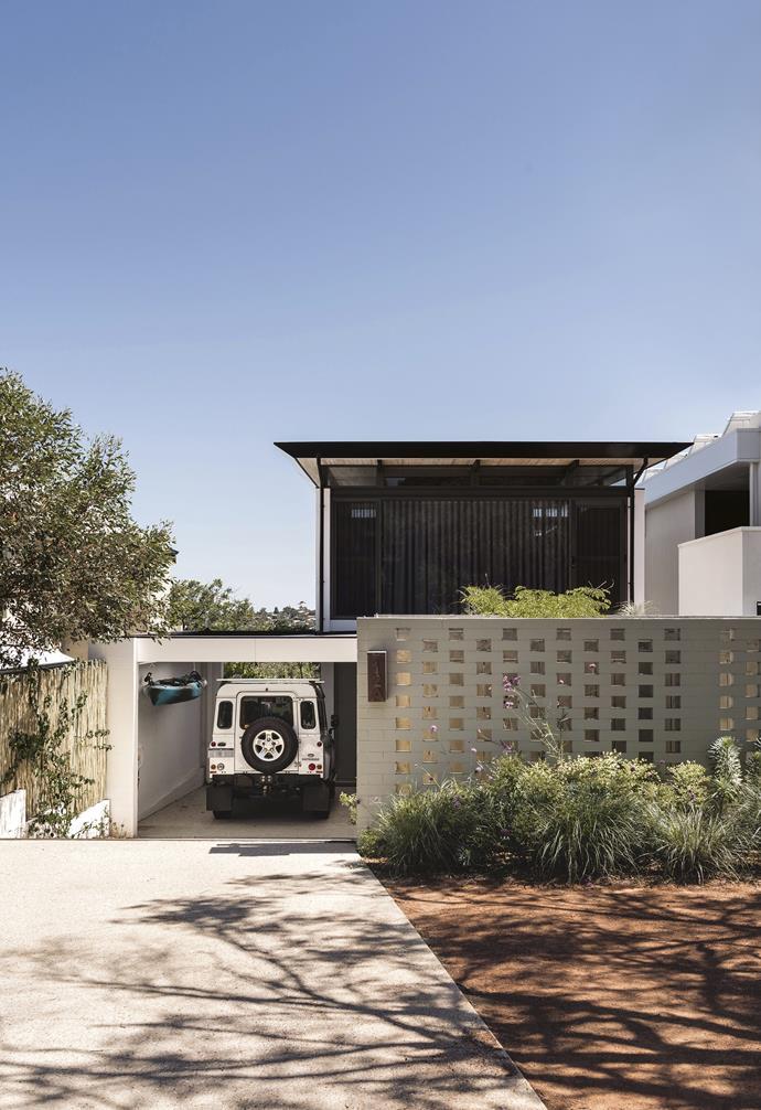 "**Exterior** The breezeblock wall, rust-coloured gravel, African grasses and euphorbias reflect a desert-inspired palette. Mailbox, [Robert Plum](https://robertplumb.com.au/|target=""_blank"")"