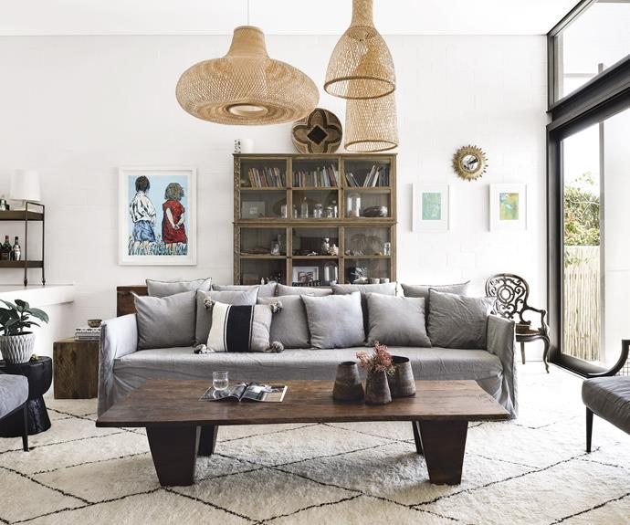 """**Living area** Handmade finds from Ethiopia and Africa remind Anna and Paul of their travels. The large MCM House sofa and armchairs add softness in a deep grey tone, perfect for a young family. Artwork: Painting (left) by David Bromley, [Bromley & Co. Art](https://www.bromleyandco.com/